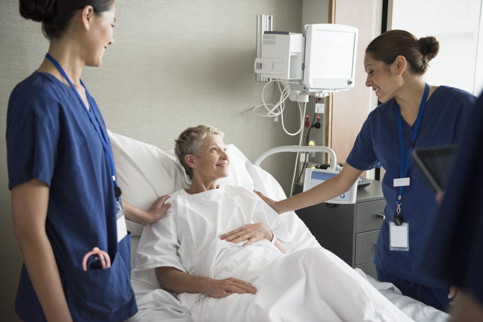 Clinicians at a patient bedside